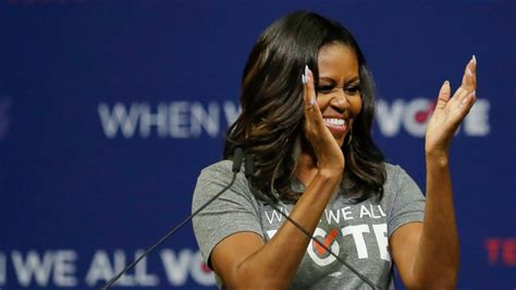 Michelle Obama earns rock star's welcome at voting rally